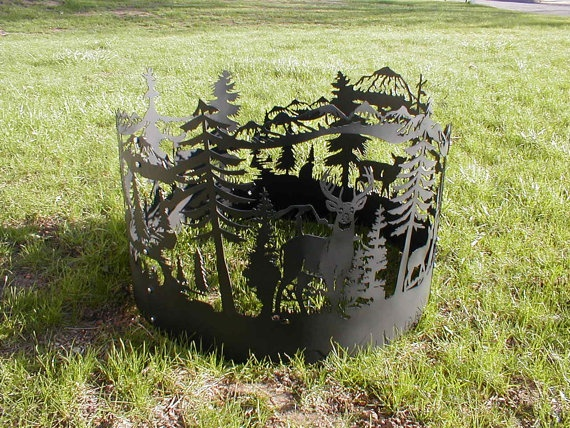 Custom fire-ring that contains a design of deer in a wooded area. Metal Deer in Woods Firering