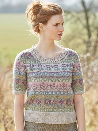 LILY from Springtime Collection Six by Marie Wallin 8 handknit designs for women by Marie Wallin. A beautiful trans-seasonal collection of quintessential feminine knitwear featuring floral intarsias, fairisles, subtle lace and twisted stitch textures. Mainly using Rowan Felted Tweed, this collection is the ideal solution to the problem of what to wear on a sunny spring day when it's still chilly outside | English Yarns http://englishyarns.co.uk/rowan-marie-wallin-springtime.html