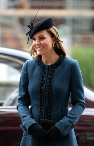Britain's Catherine, Duchess of Cambridge, arrives to visit to Baker Street tube station with Queen Elizabeth II and Prince Philip, Duke of Edinburgh, in London on March 20, 2013 to mark 150th anniversary of the London underground. (CHRIS RADBURN / AFP / GETTY IMAGES)