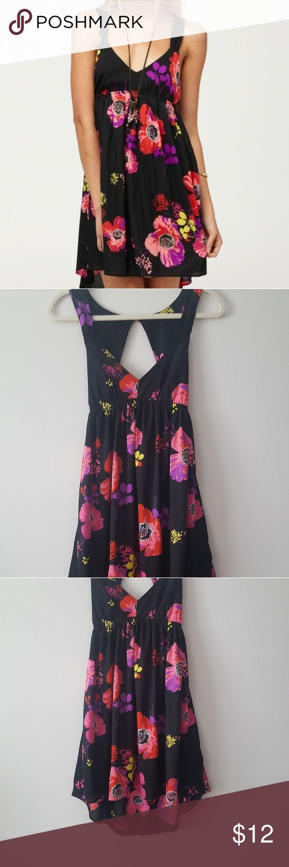 ROXY FLORAL 'LOVE SEEKER DRESS' XS Surf brand Roxy multi-colored floral beachy dress Gently used, good condition  Sleeveless, empire waist mini Slight high-low hem Cut out back with elastic fitting through back Back neck button closure **not lined 100% polyester Approximately 32.5 inches in length front Approximately 36.5 inches in length back Roxy Dresses