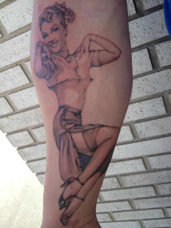 Pinup girl tattoo on forearm by Don Frey