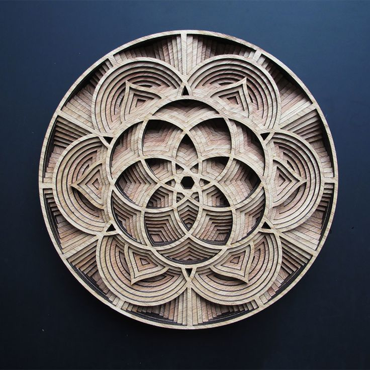 """Oakland-based artist Gabriel Schama works with mahogany plywood to create intricate relief sculptures that """"twist, intersect, and overlap to create various mandala-like forms"""".   More art on the grid via Colossal"""