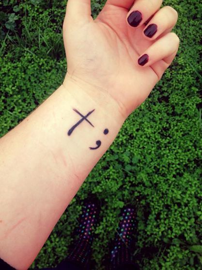 """""""Because of Christs love my story isn't over yet. """" Cross meaning Christs love, semi-colon where a sentence could've ended but it did not.  semi colon project: Suicide awareness, cross, self harm, cutting, tattoo"""
