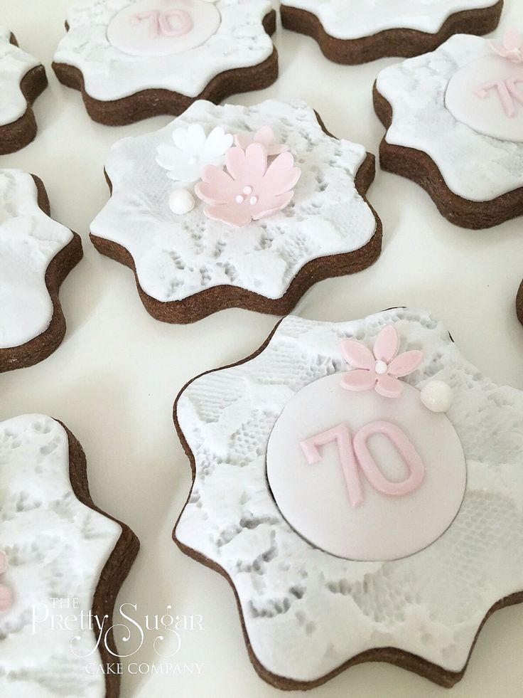 70th birthday cookies in pink and white with lace and sugar blossoms