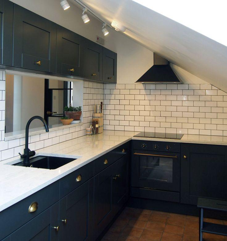 Kitchen (House F)  - bespoke shaker kitchen unit  - quartz carrara worktop  - black sink and mixer tap  - white metro wall tiles  - aged brass ironmongery  - terracotta floor tiles