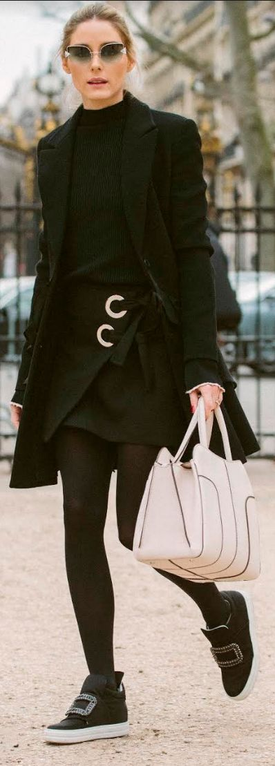 Who made Olivia Palermo's gray sunglasses, black coat, ring wrap skirt, beige handbag, and black crystal sneakers?