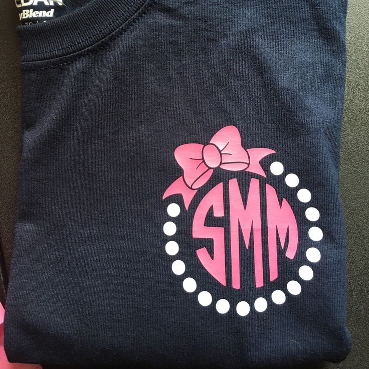 You can request our monograms in whatever colors you want ! Love this navy tee with the pink bow and pearl monogram ! More