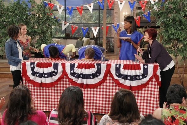 Jeff Foxworthy participates in a pie eating contest on The Talk as judge Marcela Valladolid  watches on!