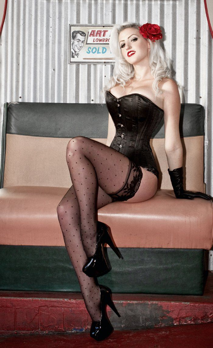 Sexy pinup girl on thigh highs goes beyond
