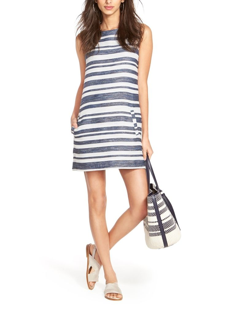 Heading straight to the beach after work in this cute blue and white striped shift dress that can be paired with flats or heels on a summer day.