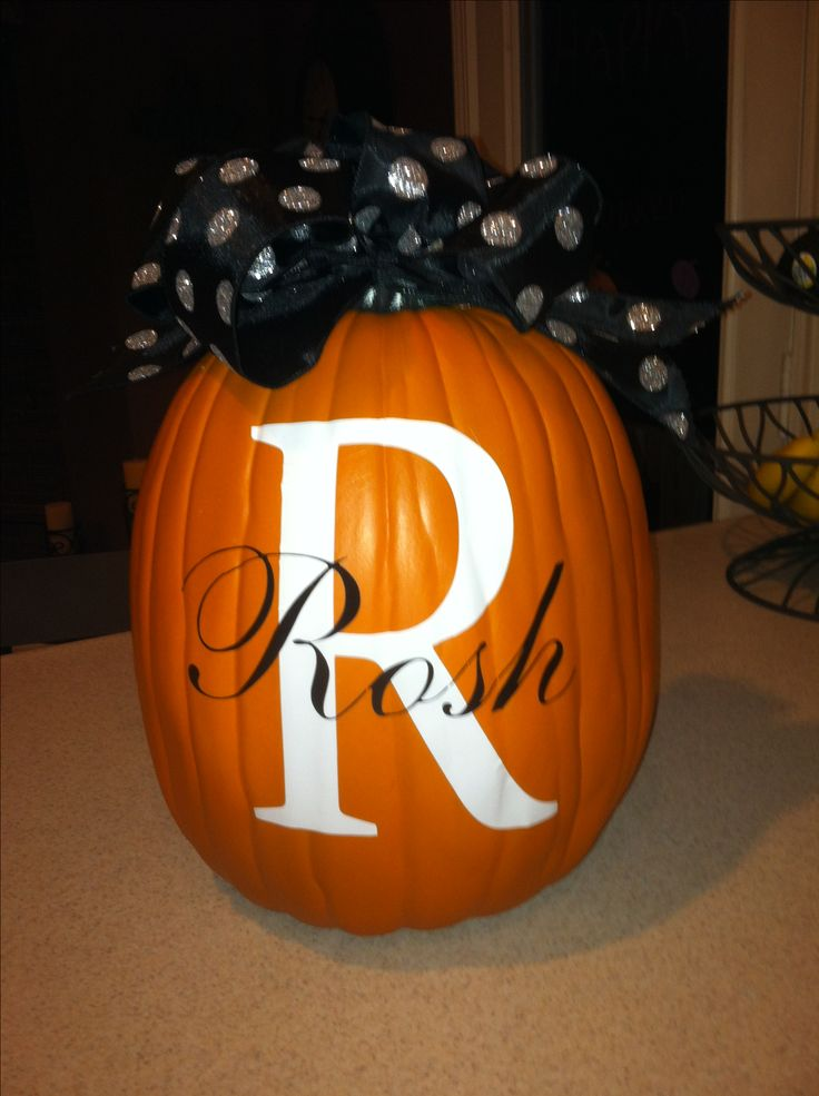 fake pumpkin from michaels and cut vinyl letters with my cricut then