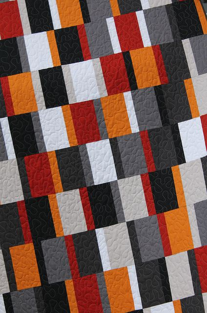 Simple but effective - 2 shades of orange, three of grey and black & white.  Love the rhythm of the repeating pattern.  Betsy front by B's Modern Quilting