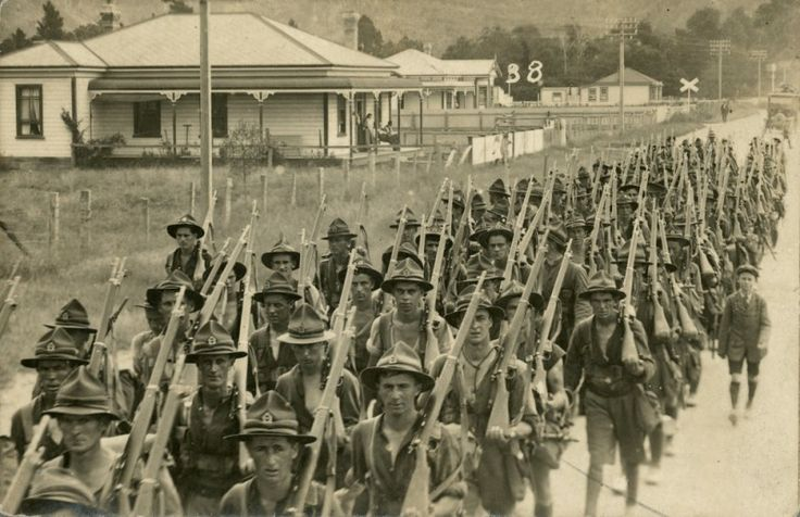 Sharing Soldiers marching with rifles; returning to Trentham camp? [P2-39-115] at Upper Hutt City Library