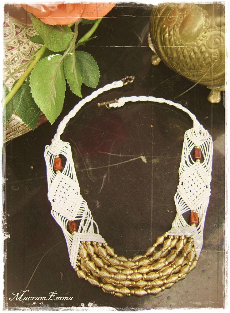 Cream Macrame Necklace with Gold Beads & Red jasper..A strong protection gemstone, red jasper is known to protect against hazards of the night.Is very lucky for actors. Jasper is one of the oldest known gemstones. It is mentioned in the Bible several times...a strong securing gemstone. It is a powerful protection against things that are not good for you and it eases emotional stresses, making it a wonderful gemstone to have in your home..by MacraEmma...