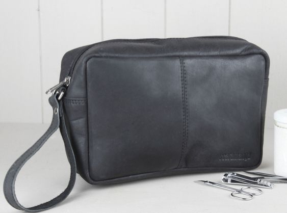 Our classic men's leather wash bag is handmade from our distressed Hunter black leather and has enough space for your all your toiletries and more - perfect for those weekends away and holidays. #leather #travelaccessory #washbag