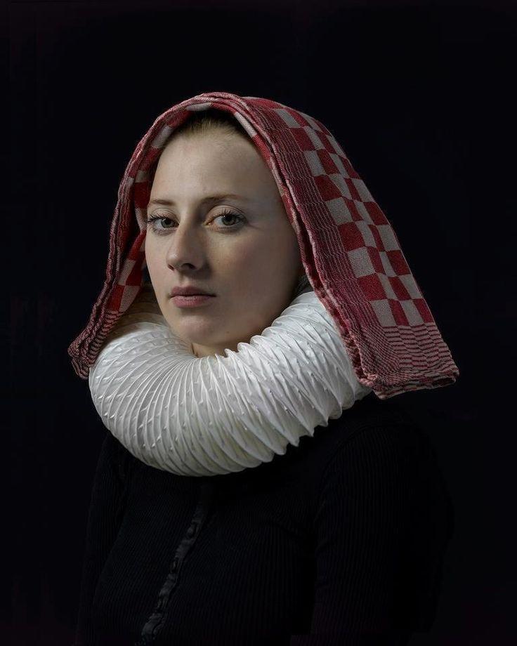 Towel headress  and air-duct necklace : Hendrik Kersten's daughter .