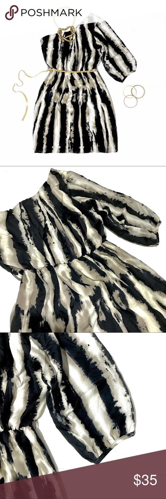 Poema One Shoulder Animal Print Mini Dress By Poema. Made in USA. One three-quarter sleeve shoulder mini dress with animal print. Lined with belt loops. Perfect condition; like new. Size small. Classic cocktail dress! Pair with heels and a belt with gold jewelry for a chic look⚡️. ♥️20% off bundles of 2+♥️ Poema Dresses One Shoulder
