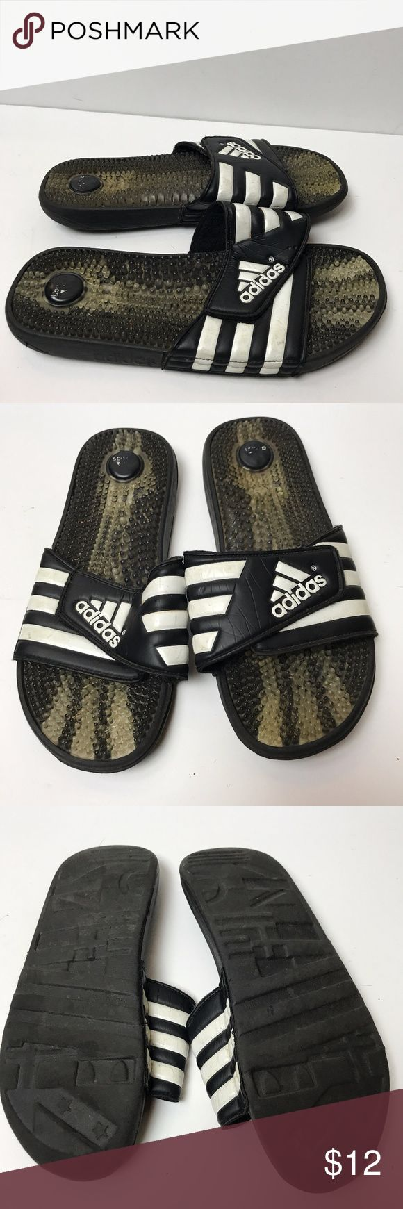 ADIDAS ADISSAGE BLACK WHITE SLIDES SANDALS MASSAGE Make this yours! Like a spa for your feet, these men's slides have massage nubs on the footbed that soothe and relax tired muscles. The adjustable bandage upper dries quickly and features 3-Stripes and an adidas Badge of Sport. An EVA outsole offers lightweight comfort.  SIZE MEN'S 10. adidas Shoes Sandals & Flip-Flops