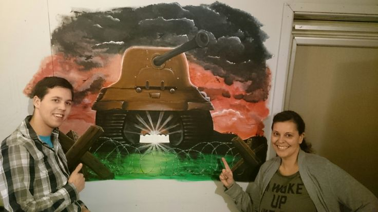 My son and me with my freshly made mural!