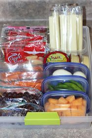 Healthy snacks, portioned out into separate containers.  When the kiddos want a snack, they can just go to the snack bin in the refrigerator.