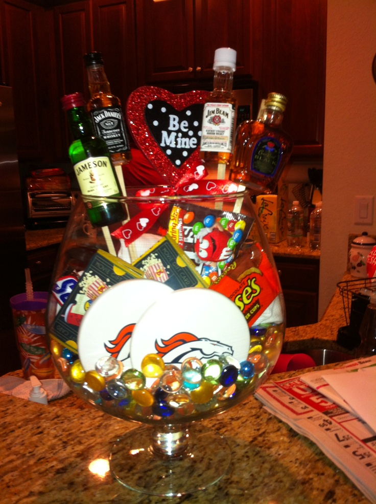 It's the Man Bouquet! Favorite team coasters paired with favorite whiskeys. Movie ticket gift cards paired with candy! Shirts are behind to help hold everything up. <3
