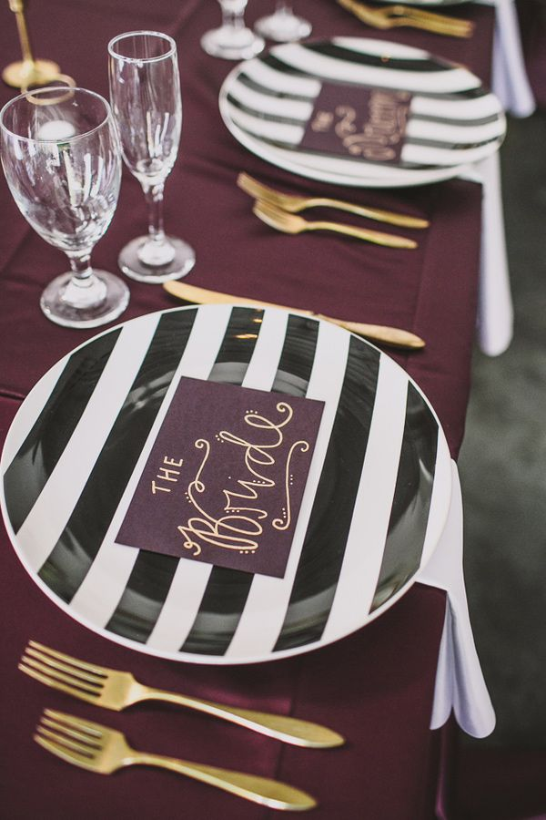 striped plates! photo by @Emily @ Anna Delores Photography http://ruffledblog.com/california-art-gallery-wedding #plates #striped #weddingideas