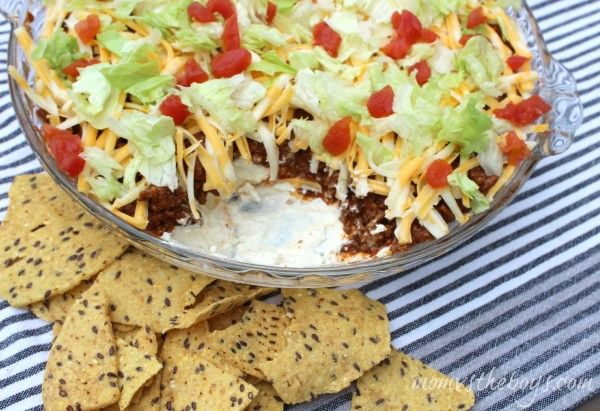 """50 Delicious Super Bowl Snacks."" The Beefy Taco Dip recipe is AMAZING. I always end up with an empty pan at the end of the night."