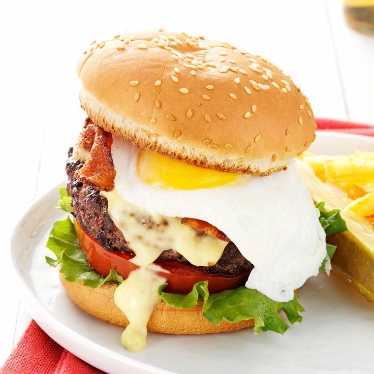 Eggs Benedict Burgers Recipe -To feed my daughter's hungry cowboy friends after a rodeo, I created these with leftover burgers, hollandaise and bacon. They were a huge hit! —Bonnie Geavaras-Bootz, Scottsdale, Arizona