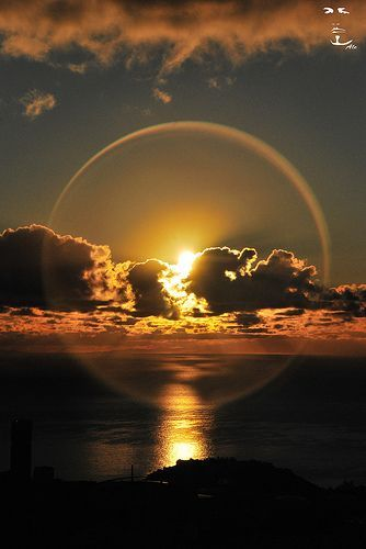 Halo Sunset ~ is an optical phenomenon produced by light interacting with ice crystals suspended in the atmosphere.