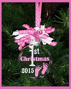 """Baby's First Christmas Ornament with pink feet is a 3"""" glass ball ornament with Baby's First Christmas desing """"floating"""" INSIDE the ornament. The outside is decorated with matching polka dots (not sho"""