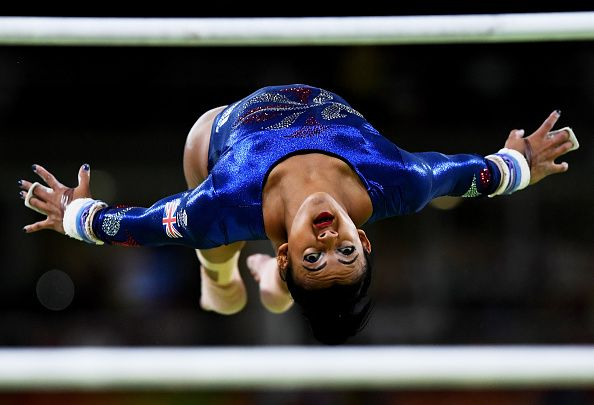 Elissa Downie of Great Britain competes on the uneven bars during Women's qualification for Artistic Gymnastics on Day 2 of the Rio 2016 Olympic...