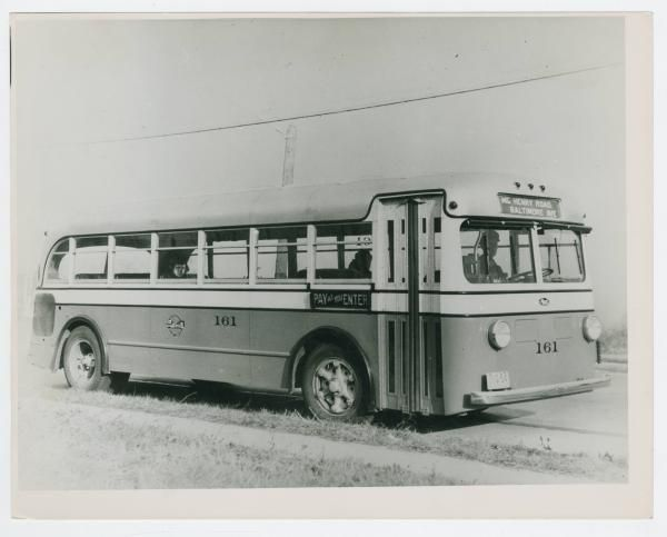 "Reverse reads: ""McHenry Rd. Baltimore Ave Buss, Cincinnati, Ohio."" This photograph shows a Mack bus with license plate number 11-Q-54. Bus number 161, there is a sign which reads ""Pay as you Enter"" next to the door."