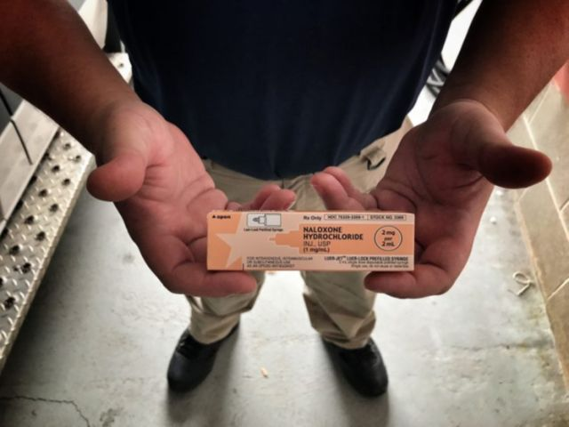 Dylan Handley, head of the Mason County EMS, holds a vial of Naloxone, better known as Narcan, which is administered to stop the effects of a drug overdose (Photo: Holly Bailey/Yahoo News)