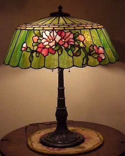 "Double pink floral deign on opposite sides. 20 1/2"" diameter; lamp stands just over 25"" tall."