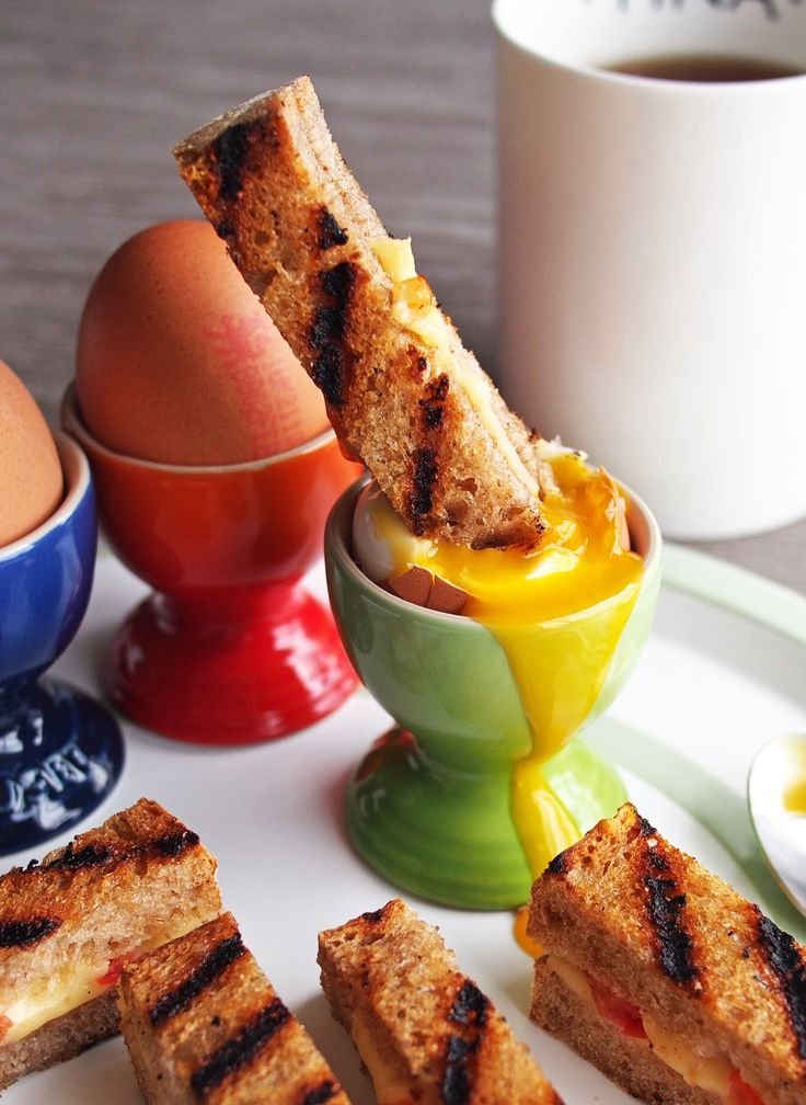 Dippy Eggs and Soldiers are a classic British breakfast. This is a recipe uses grilled cheese soldiers for dipping into the soft-boiled egg.