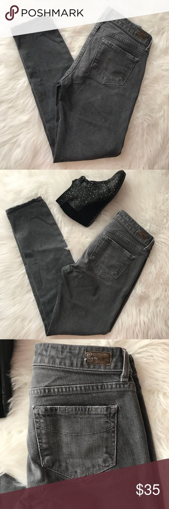 "Paige Skyline Ankle Skinny Peg Jeans sz 28 Paige Skyline Ankle Skinny Peg Jeans in dark grey.  Waist 15.5"". Inseam 29"". Rise 8"". Soft broken in jeans in great preowned condition. Paige Jeans Jeans Skinny"