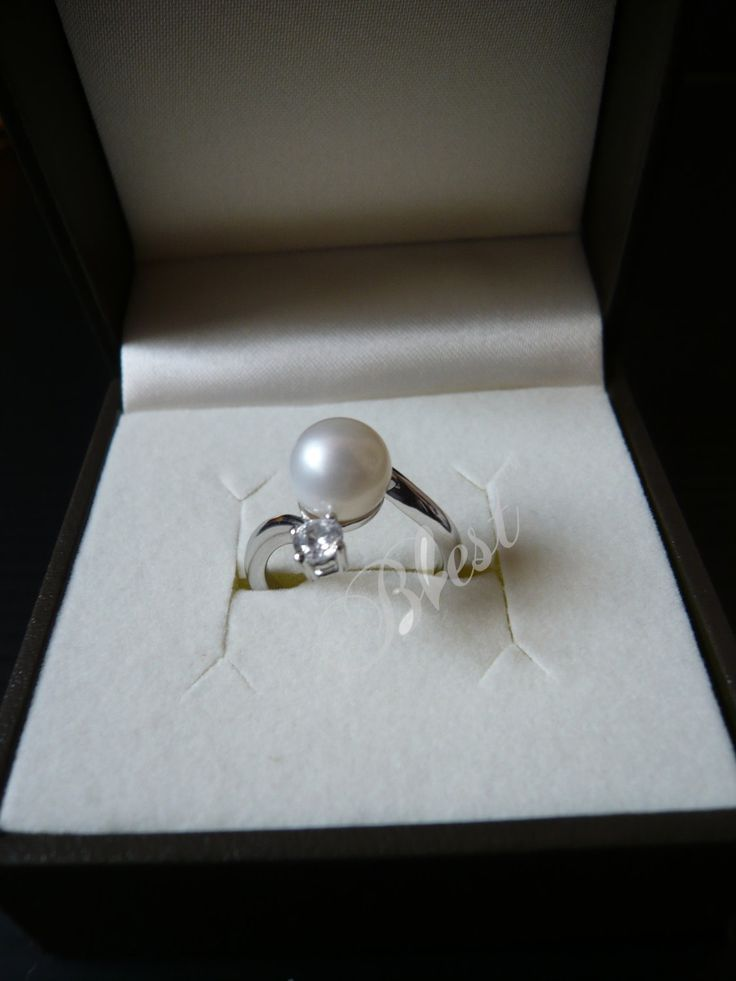 I had a dream about a pearl wedding ring like this. Which is weird, because I wasn't planning on having a ring like this.