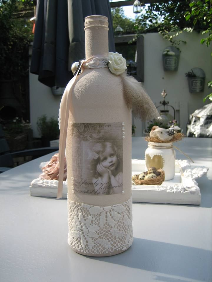 fles bewerkt met gesso en versierd