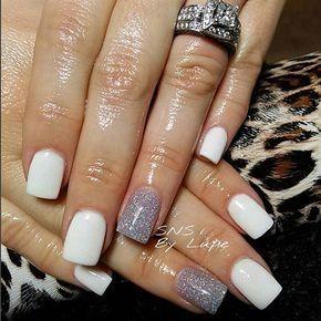 White nail polish with pale blue glitter nail.