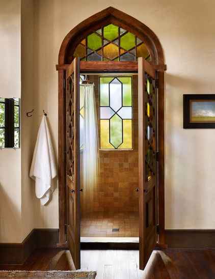 A truly original application of stained glass. I might try to squeeze in an extra shower every day with this great bathroom. Notice the stained glass inside the shower as well as on the entry doors to the shower. This is a great concept that would work for an oversize shower, especially fitting for Spanish or Mediterranean style.