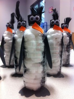 Penguins made out of water bottles, foam paper, google eyes and a black feather