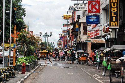 Malioboro, Yogyakarta - enjoy a romantic evening walk with various batik or food stalls along the street