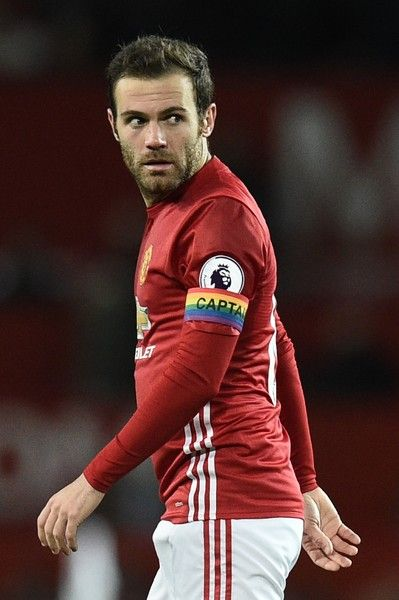 Manchester United's Spanish midfielder Juan Mata wears the captain's armband during the English Premier League football match between Manchester United and West Ham United at Old Trafford in Manchester, north west England, on November 27, 2016. / AFP / Oli SCARFF / RESTRICTED TO EDITORIAL USE. No use with unauthorized audio, video, data, fixture lists, club/league logos or 'live' services. Online in-match use limited to 75 images, no video emulation. No use in betting, games or single…