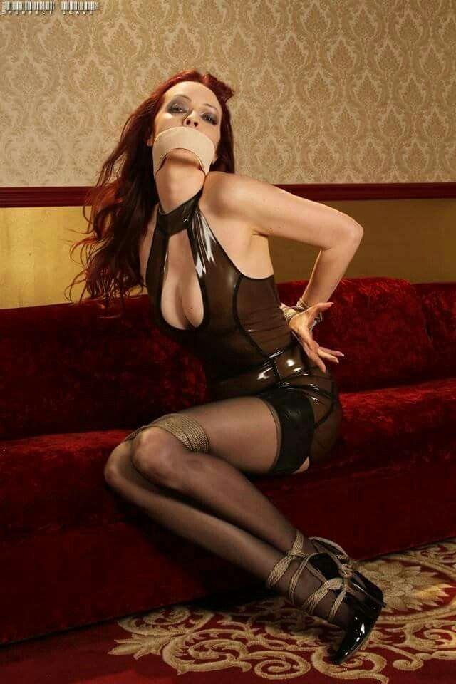 Great ass tied gagged redhead she's enjoying
