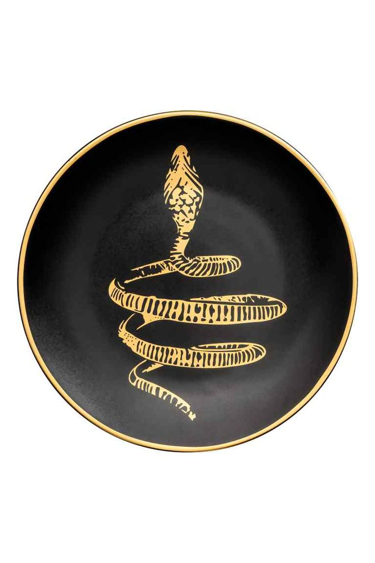Small porcelain plate: Small porcelain plate with gold-coloured print motif. Diameter 16 cm.
