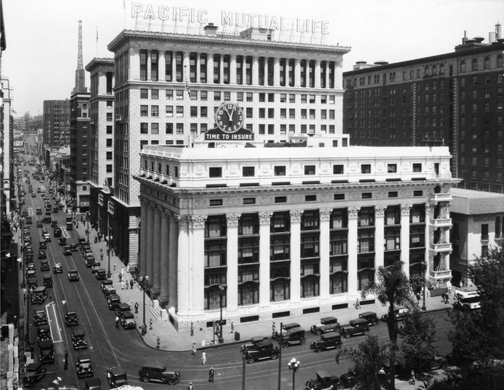 (ca. 1935)^ - 6th Street looking west at Olive Street. At right is the Pacific Mutual Life Insurance Co. building. Pershing Square is at clo...