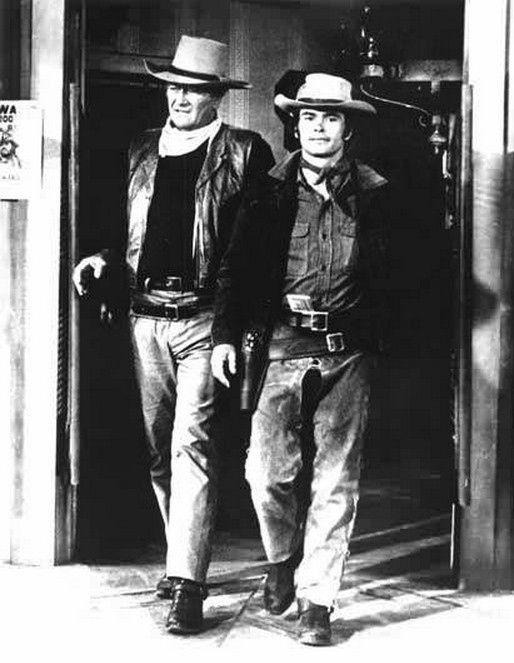 """John Wayne and Geoffrey Deuel in """"Chisum"""" Directed by Andrew McLaglen Warner Bros. 1970"""