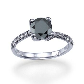 Save up and get her something different like this black diamond engagement ring.