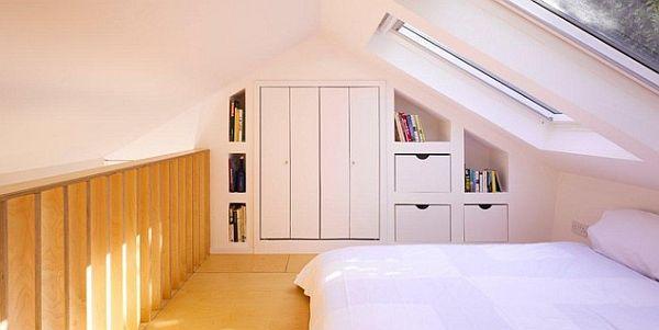 Attic bedroom in a loft with fancy window treatments