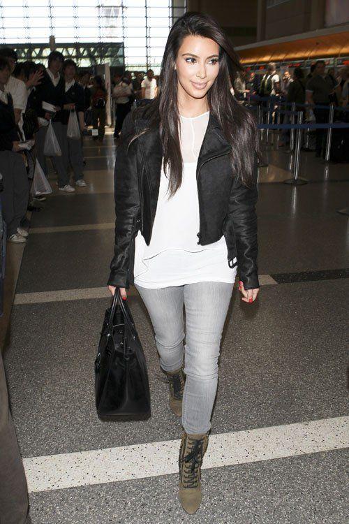 Kim Kardashian wearing Hermes So Black Birkin 35 Bag, Giuseppe Zanotti For Balmain Lace-Up Studded Booties and Black Orchid Jewel Skinny Jean in Ice.